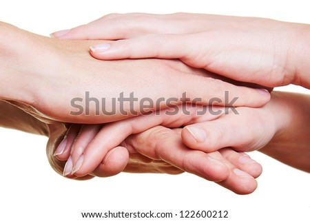 Team stacking many hands for motivation in a group - stock photo