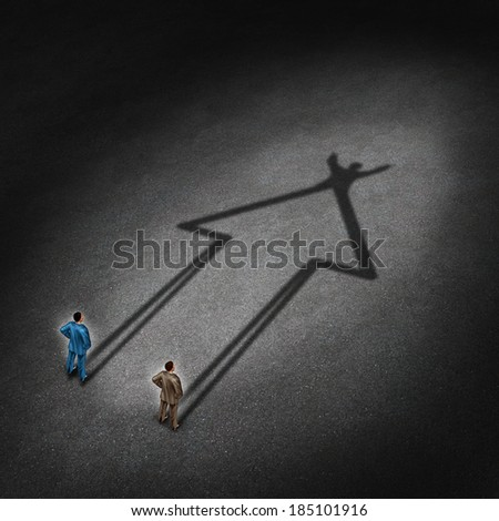 Team success and partnership cooperation for a successful winning strategy as a business concept with two businessmen casting a shadow that is in the shape of an upward arrow with a victory gesture. - stock photo