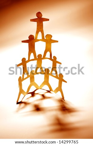 Team support human pyramid - stock photo