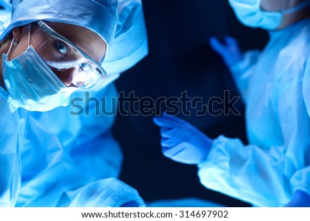 Team surgeon at work on operating in hospital - stock photo