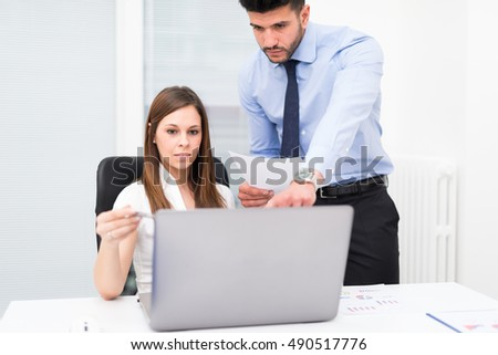 Team using a laptop computer in her office