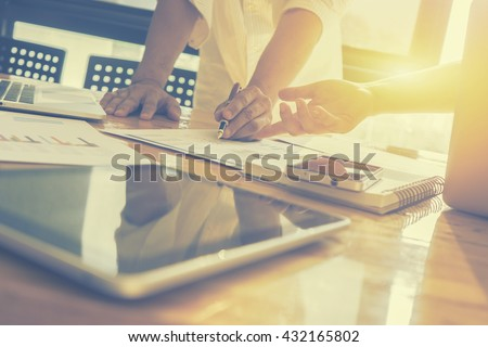 Team work and team meeting concept,man and woman operate in the office with collaborative teamwork,Project managers meet a business crew working with new startup. Analyze business plans,vintage color - stock photo