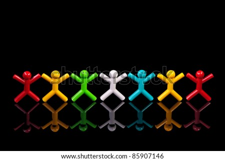 Team work concept. Colorful dolls on black background.