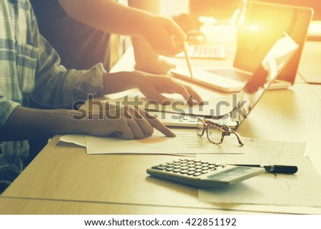 Team work concept,team meeting,Business people using laptop at office, business crew working with new startup project laptop. Project managers meeting. Analyze plans.selective focus,vintage color