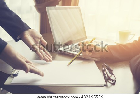 Team work concept,team meeting,man and woman working in the office. working day in office. two businessmen at work.collaborative teamwork. Project managers with start up.selective focus,vintage color - stock photo