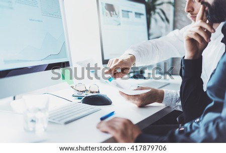 Team work process.Businessman teamwork new project.Photo young business crew working with startup modern office.Desktop computer on table,graphics screen monitor. Blurred,film effect. Horizontal - stock photo