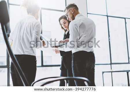 Team work process. Photo young professionals crew working with new startup project modern loft office. Project managers meeting. Analyze business plans laptop. Blurred background, film effect - stock photo