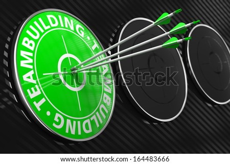 Teambuilding Concept. Three Arrows Hitting the Center of Green Target on Black Background. - stock photo