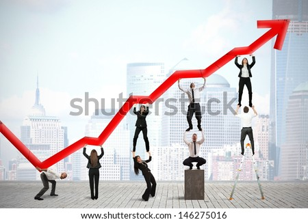 Teamwork and corporate profit with red statistical trend - stock photo