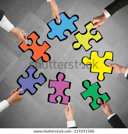 Teamwork and integration concept with pieces of puzzle - stock photo