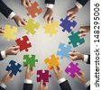 Teamwork and integration concept with puzzle pieces - stock photo