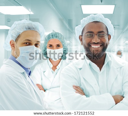 Teamwork at modern hospital lab, group of doctors