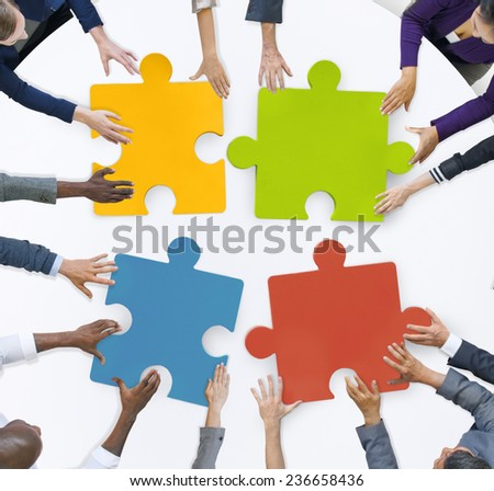 Teamwork Business Team Meeting Unity Jigsaw Puzzle Concept - stock photo