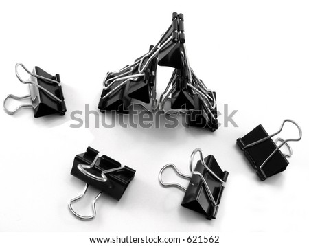 Teamwork - Butterfly clips on a white background - stock photo
