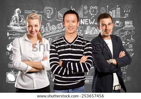 Teamwork concept. Asian man in striped pullovert, looking on camera, with folded hands - stock photo