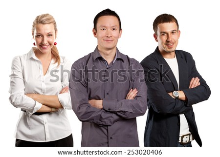 Teamwork concept. Asian man smiling, looking on camera, with folded hands - stock photo