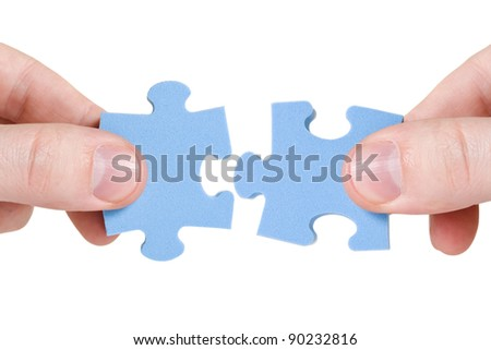 teamwork concept. two hands with different pieces of puzzle - stock photo