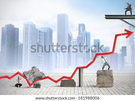 Teamwork fight against the crisis to help statistics - stock photo
