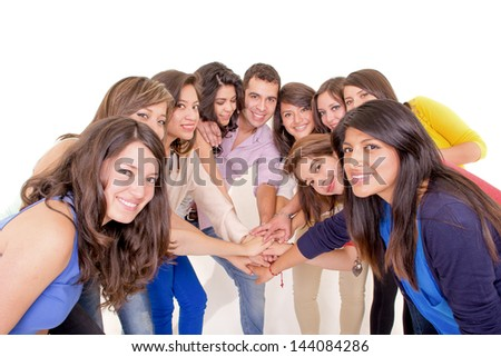 Teamwork: Group of young and diverse people joining hands - stock photo