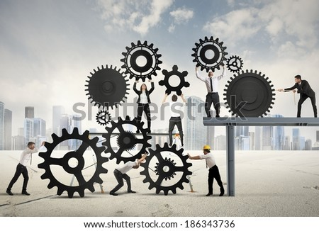 Teamwork of businesspeople at work to build a business system - stock photo