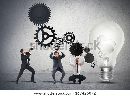 Teamwork powering an idea with gear system - stock photo