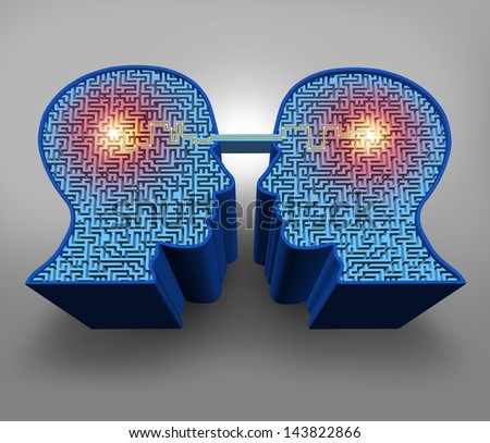 Teamwork solutions business concept as a group of three dimensional human head shaped maze or labyrinth puzzles with a connected glowing line of communication between the partners for team success. - stock photo
