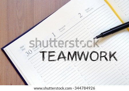 Teamwork text concept write on notebook with pen