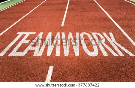 Teamwork written on running track