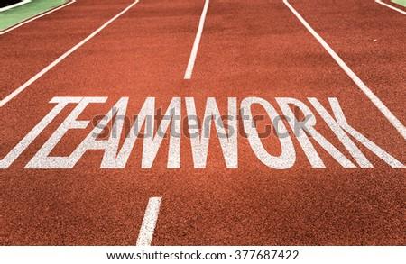 Teamwork written on running track - stock photo