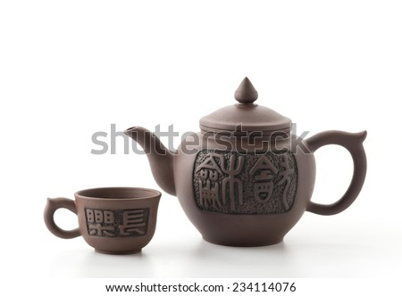 teapot and cup on white background - stock photo
