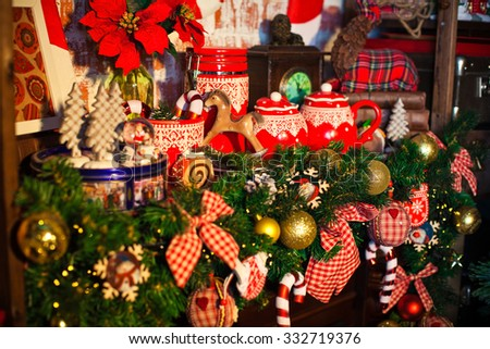 teapot and cup with christmas decorations surrounding - stock photo