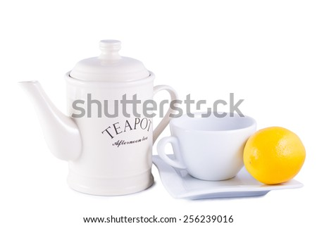 Teapot and Cup with Lemon