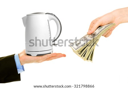 Teapot and money on hands- pawnshop concept - stock photo