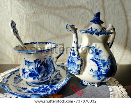 Teapot cup with saucer and teaspoon. Things in Russian traditional Gzhel style. Closeup : traditional russian tableware - pezcame.com