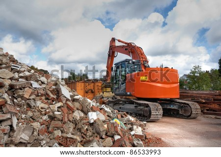Tearing down old buildings on a construction side (HDR version) - stock photo
