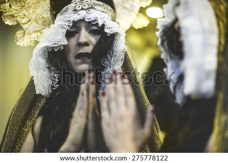 Tears, concept virgin, religion, woman with white headdress and gold crown - stock photo