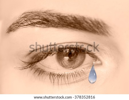Tears in eyes of crying girl - stock photo