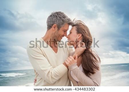 teasing couple outdoors in coastline - stock photo