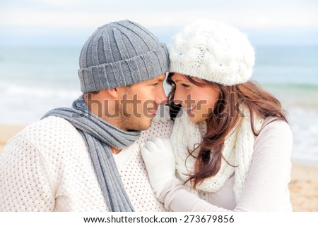 teasing warming each other outdoor portrait - stock photo