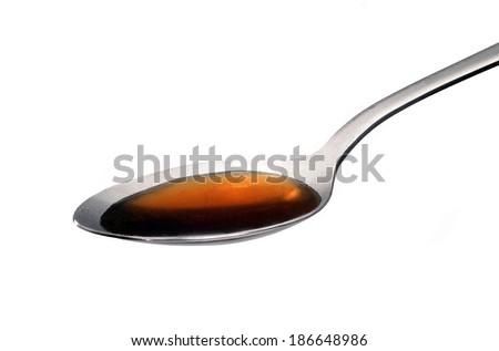 Teaspoon with medicine syrup.Broth spoon. - stock photo