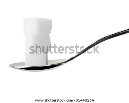Teaspoon with sugar cubes - stock photo