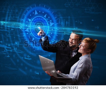 Tech couple pressing high technology control panel screen concept  - stock photo