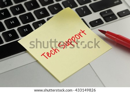 Tech Support sticky note pasted on the keyboard - stock photo