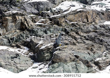 Technical climbers working on the cannon for reclamation avalanches - stock photo