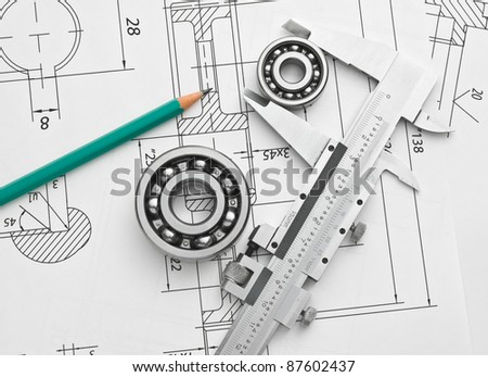 technical drawing and caliper with bearing - stock photo