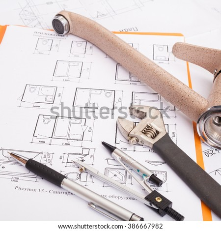 Technical drawings with pencil, compasses, tap, wrench and steel tape