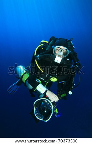 Technical Scuba Diver with Rebreather and SLR Camera - stock photo