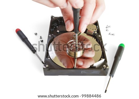 Technical surgeon working on hard drive - data recovery concept - stock photo