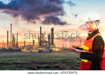 technician and Oil Refinery factory in the morning and Sunrise,Oil refinery industry, Oil refinery plant at twilight with sky background,  oil refinery industry plant along twilight morning - stock photo