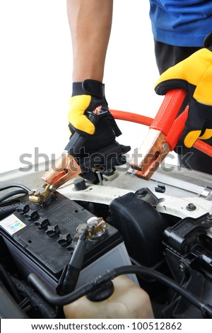 technician charge vehicle battery with isolated white background - stock photo